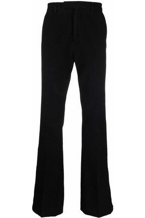 AMIRI Wide-leg wool-blend trousers