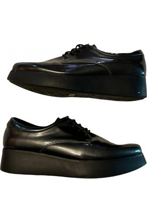Sixtyseven Patent leather mules & clogs
