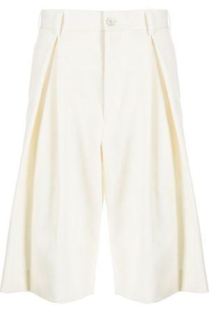 Comme des Garçons Pleated flared bermuda shorts