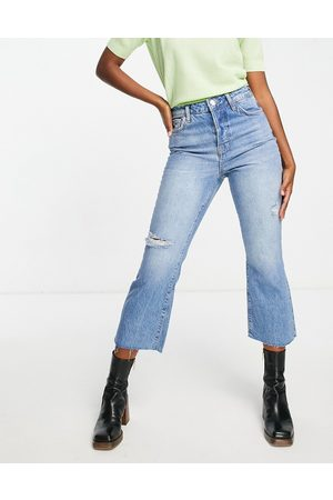 River Island High waisted ripped kick flared jeans in medium blue-Blues