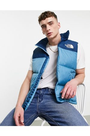 The North Face 1996 Retro Nutpse hooded vest in blue-Blues