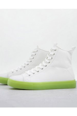 ASOS Lace up canvas sneakers in with green transparent sole