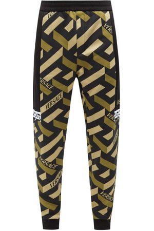 VERSACE Men Sweatpants - La Greca-print Jersey Track Pants - Mens - Multi