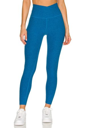 Beyond Yoga At Your Leisure Midi Legging in Blue.