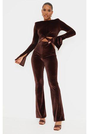 PRETTYLITTLETHING Chocolate Velvet Shoulder Pad Twist Waist Jumpsuit