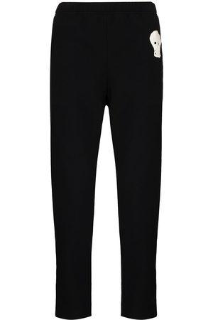 Alexander McQueen Men Sweatpants - Skull-embroidered zip-ankle tack pants