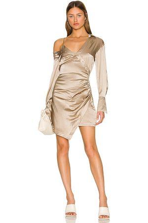 Nicholas Eliana Layered Asymmetric Drop Shoulder Mini Dress in Beige.