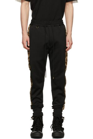 MASTERMIND Men Sweatpants - Black Leopard Lined Sweatpants