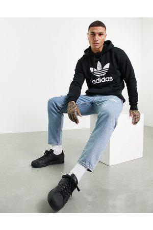adidas Adicolor large trefoil hoodie in black