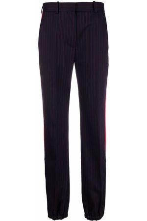 Victoria Beckham Side-stripe print trousers