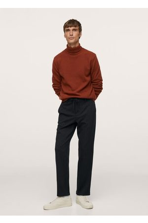 MANGO Tapered fit striped pants