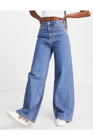 Weekday Women High Waisted - Ace organic cotton high waist wide leg jeans in mid wash 90s blue-Blues