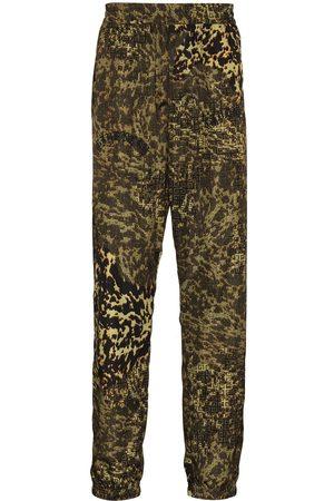 Givenchy Men Sweatpants - GIV 4G MASH UP ALLOVER NYLON TRK TRS BRW