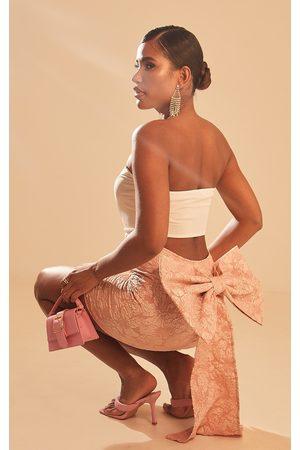 PRETTYLITTLETHING Rose Textured Bow Back Mini Skirt