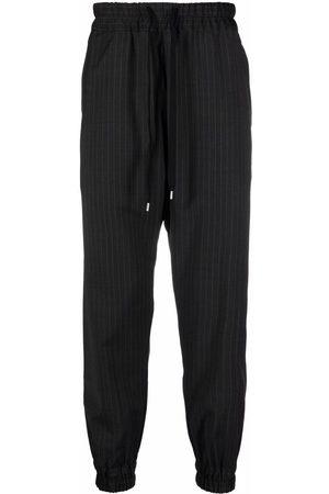 Nº21 Men Sweatpants - Pinstripe-pattern tapered-leg track pants - Grey