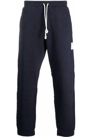 Champion Men Sweatpants - Logo-patch cotton track trousers